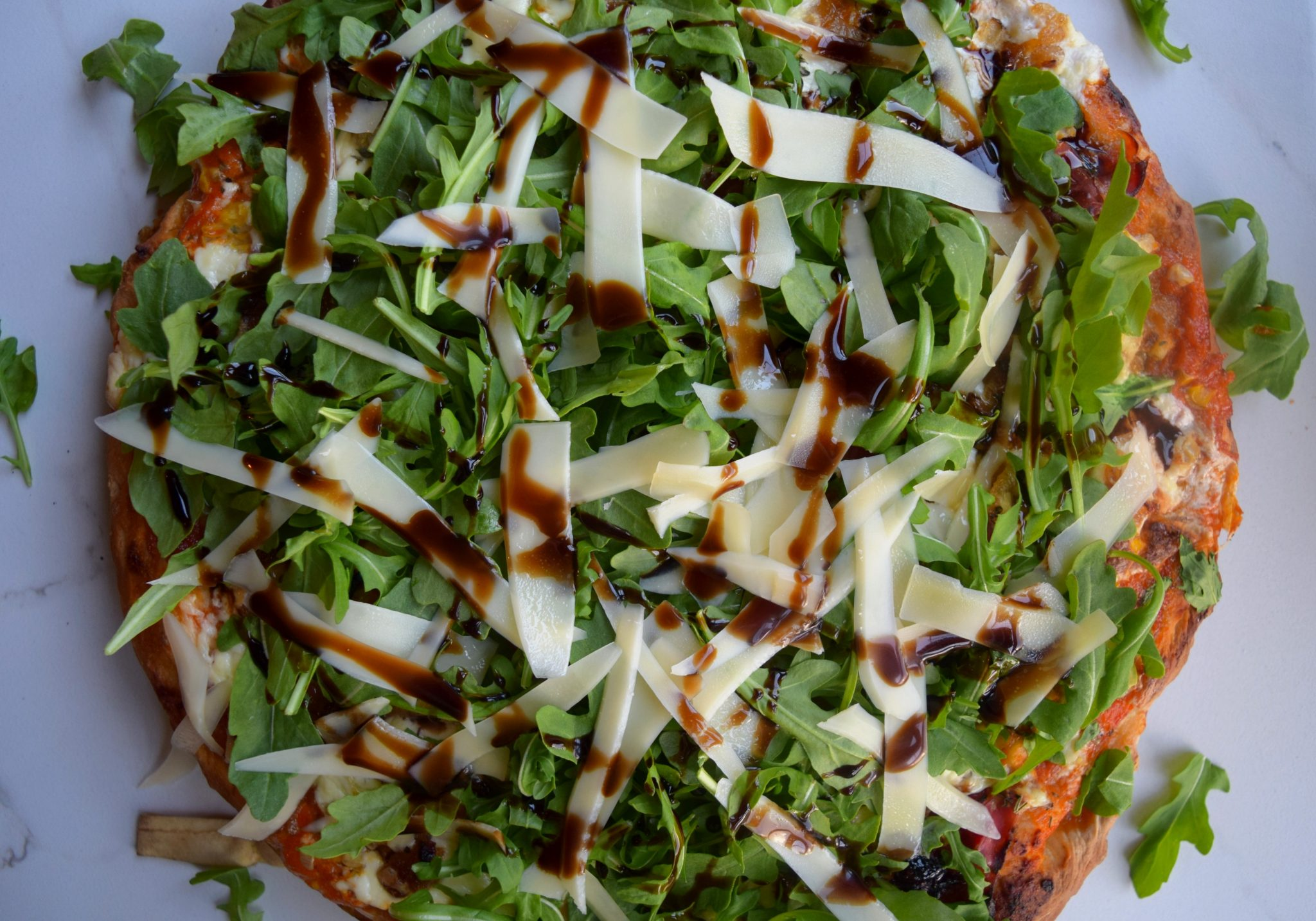 Caramelized Onion, Prosciutto, Corn and Arugula Pizza