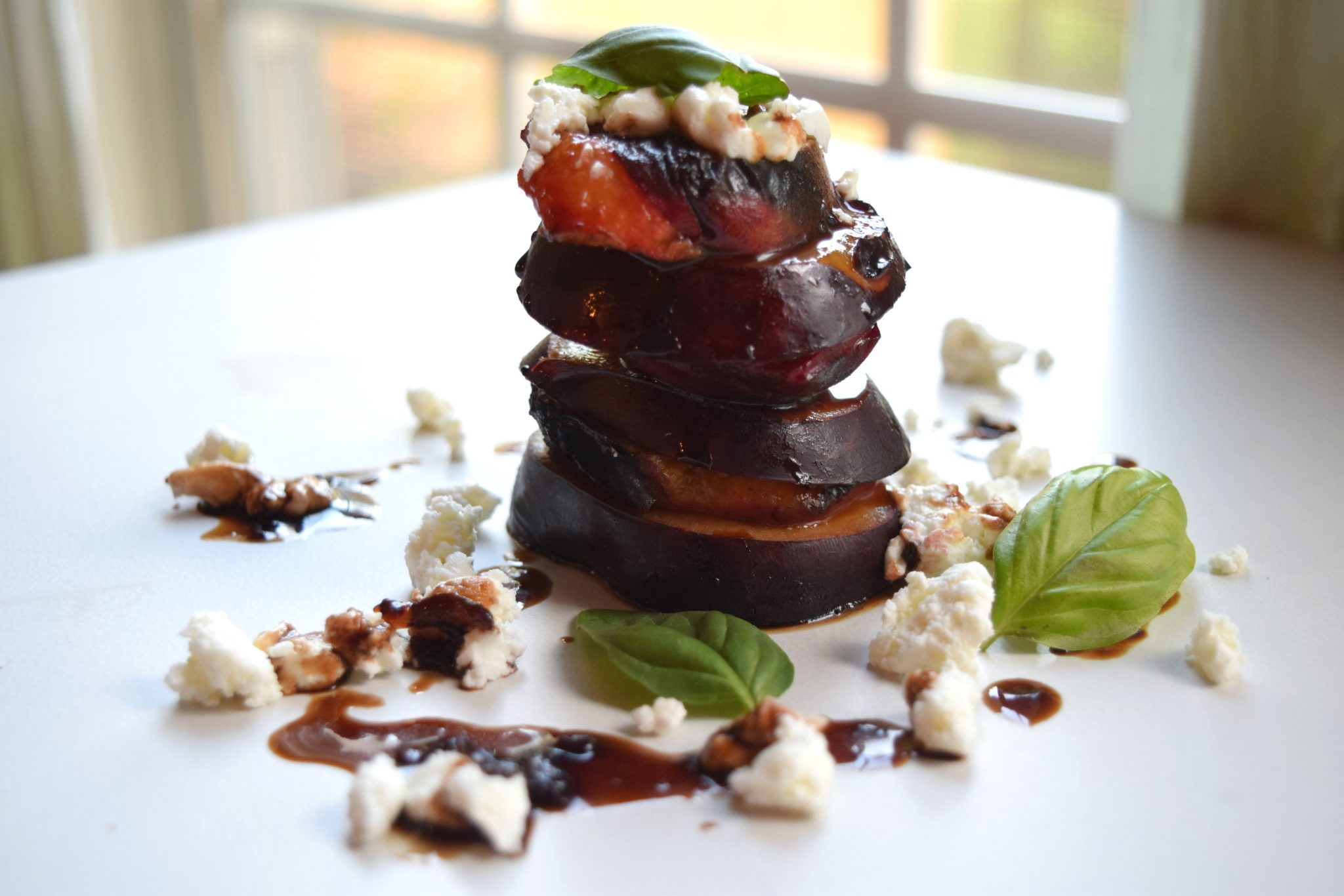 Grilled Plum and Peach Stacks with Goat Cheese and Balsamic Fig Reduction