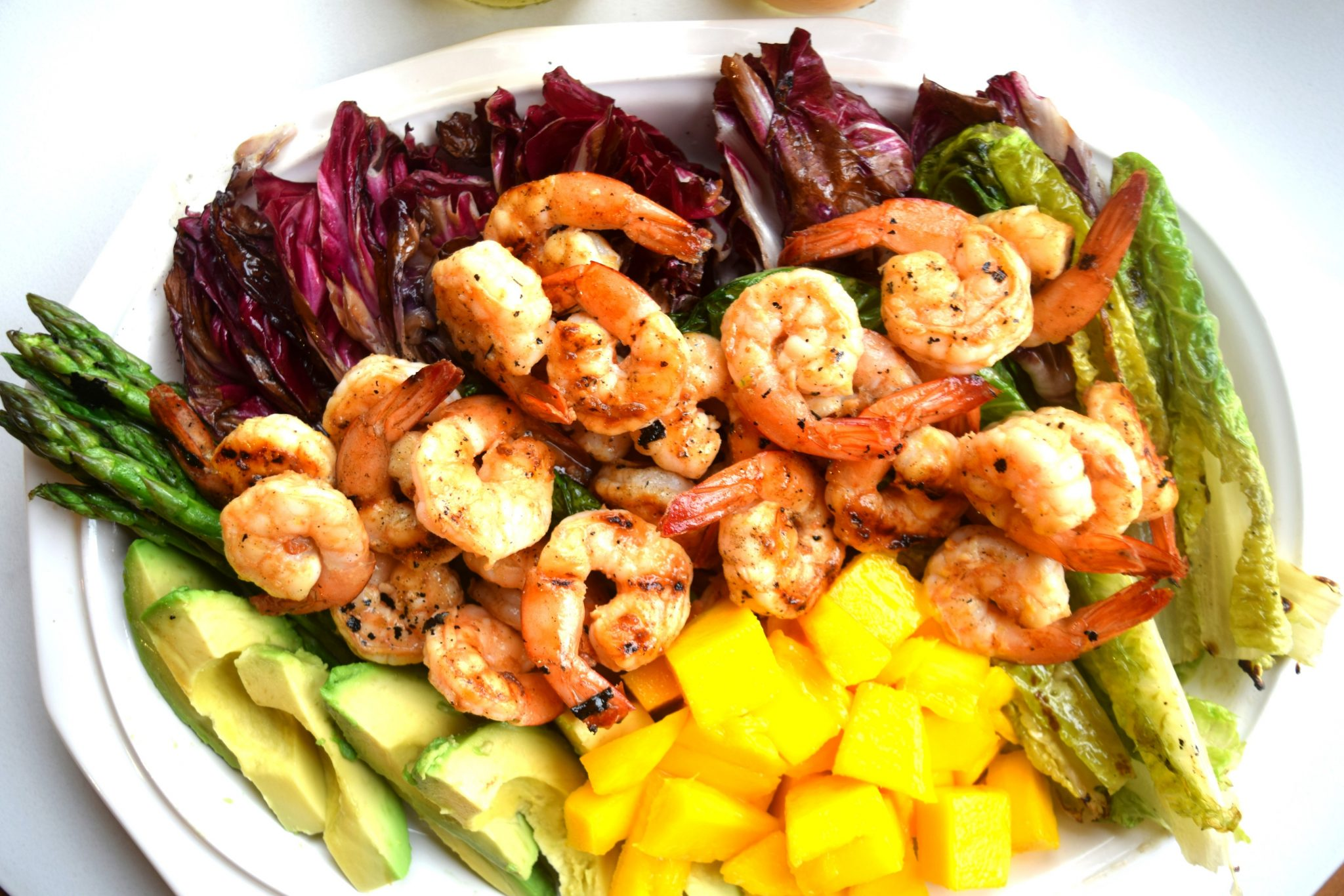 Grilled Radicchio and Romaine Salad with Grilled Shrimp and Mango Dressing