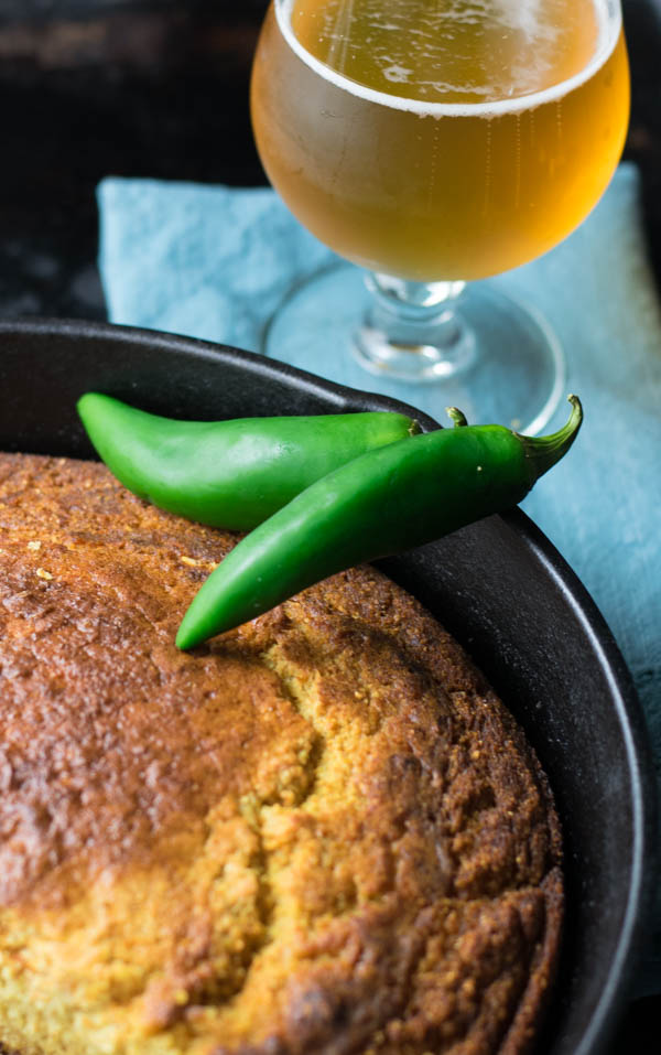 Jalapeno Pale Ale Skillet Cornbread is flavored uniquely with a jalapeno pale ale beer for an adult upgrade to a classic skillet buttermilk cornbread.