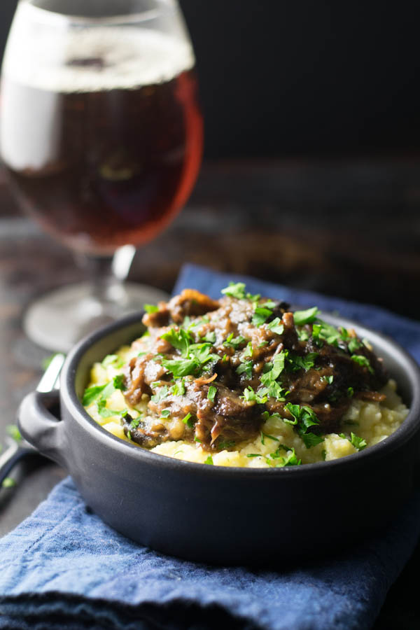 Pumpkin Ale Braised Short Ribs with Mushrooms and Polenta is a rich and delicious dish perfect for warming the heart and soul during cold times.
