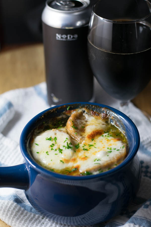 Bourbon Barrel Aged Russian Imperial Stout French Onion Soup is rich and smooth with french baguette croutons and topped with melted gruyere cheese