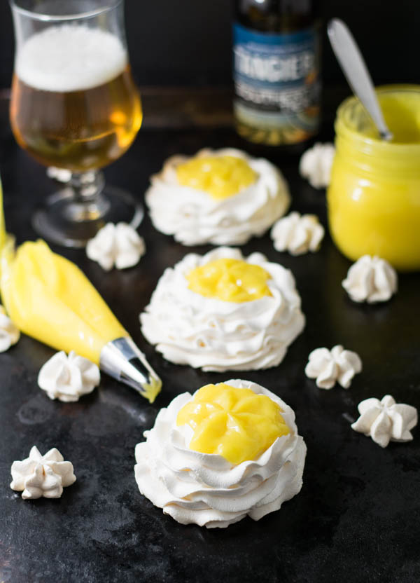 Tangerine IPA and Meyer Lemon Curd Meringue Nests are a bright and flavorful dessert made with classic lemon curd with beer and pipped into a meringue nest