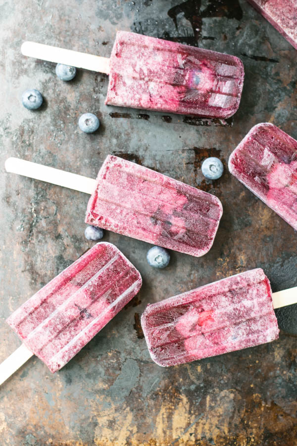 Briney Melon Gose and Blueberry Popsicles are an adult frozen treat to beat the heat with a sour ale and fruity blueberries on a stick for Popsicle Week!