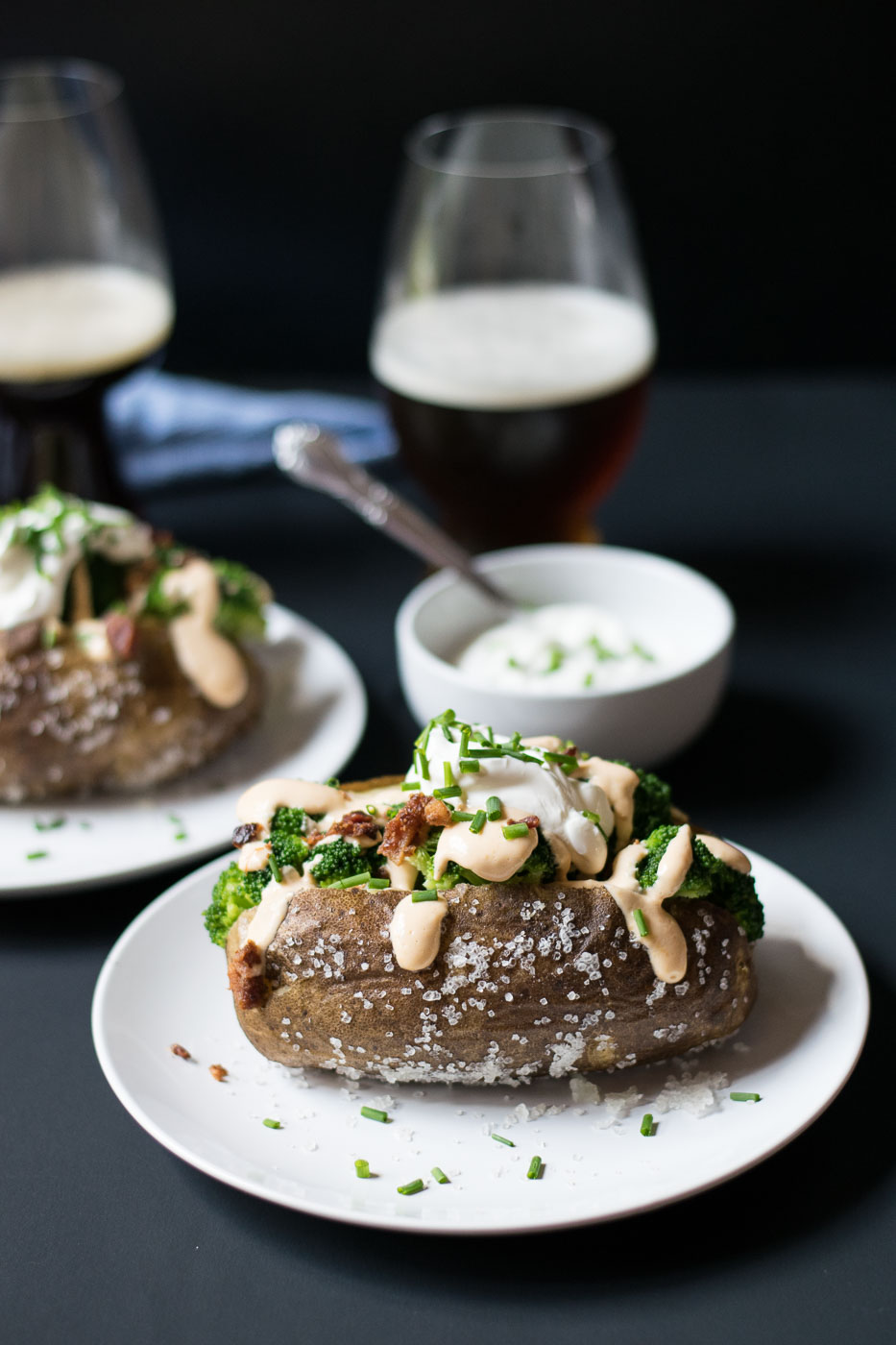 Steakhouse Loaded Baked Potatoes with Beer Cheese is just like a classic fancy baked potato you would find in an expensive steakhouse. This potato is made extra special and delicious with a heaping amount of beer cheese on top!