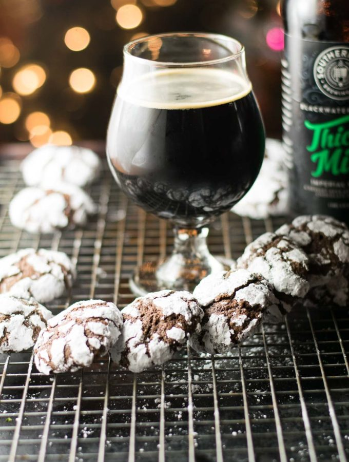 Chocolate Mint Stout Crinkle Cookies are a delicious holiday classic.  These have the additional layer of mint flavor that comes from a chocolate mint stout for a tasty chocolate mint brownie cookie perfect for the holiday cookie tray!